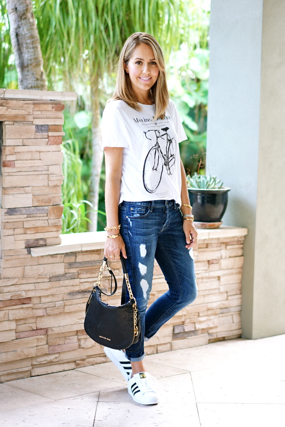 Graphic tee, distressed jeans, Adidas sneakers