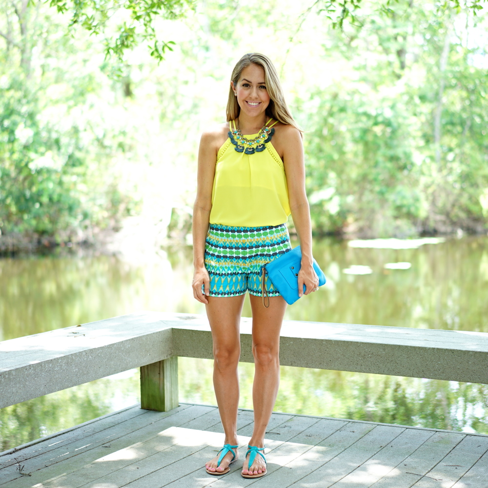 Yellow tank, pattern shorts, blue clutch