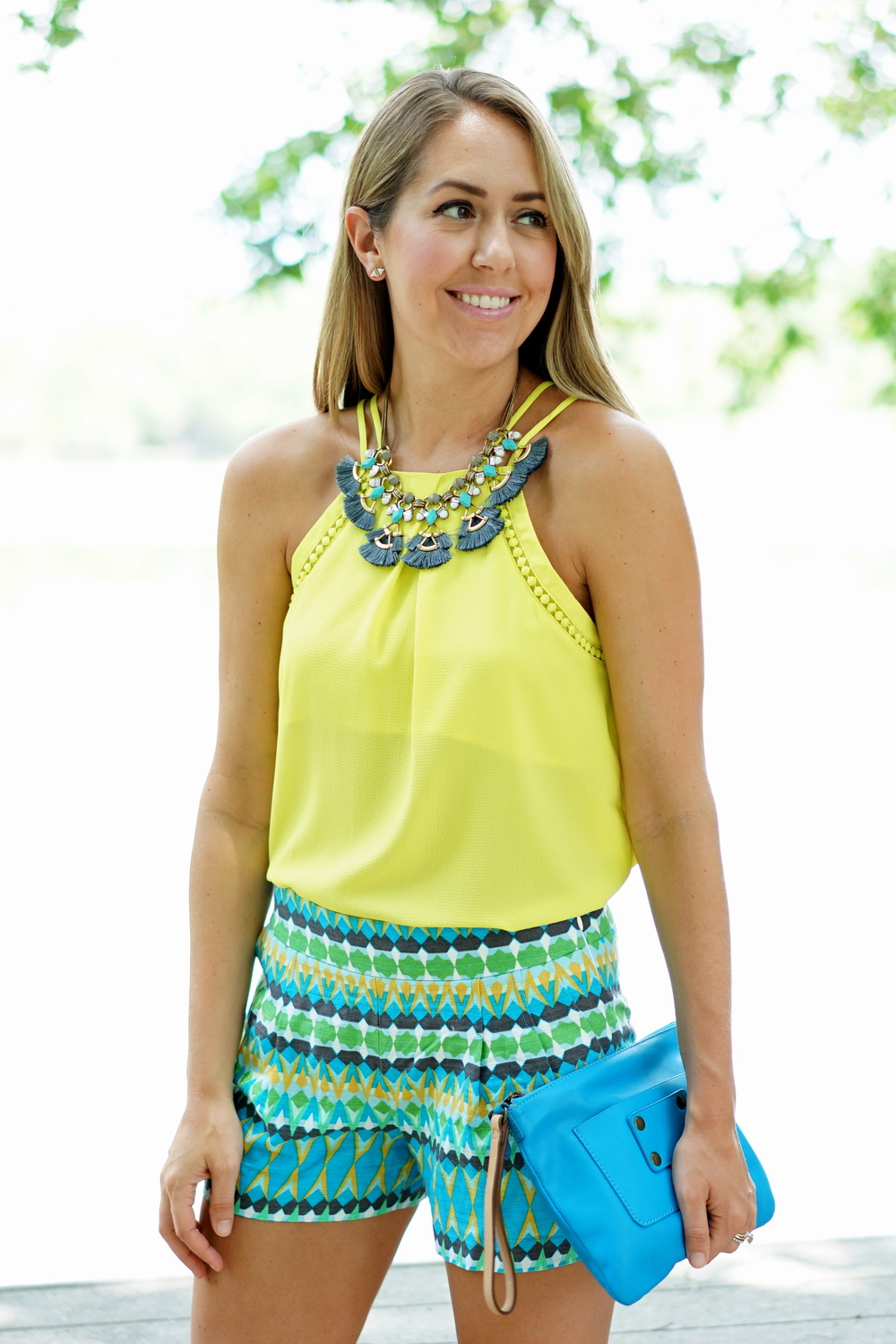 Yellow tank, printed shorts, blue clutch, Stella & Dot necklace