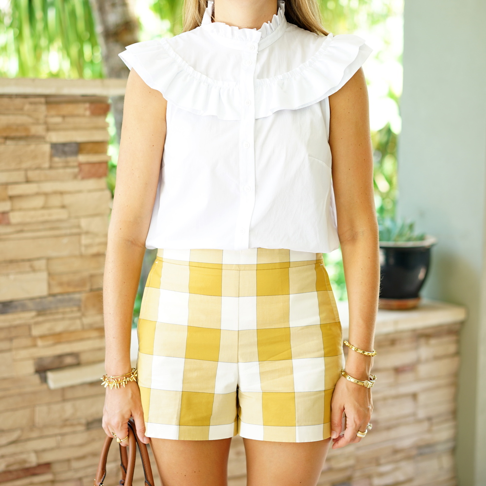 White ruffle collar shirt, yellow gingham shorts