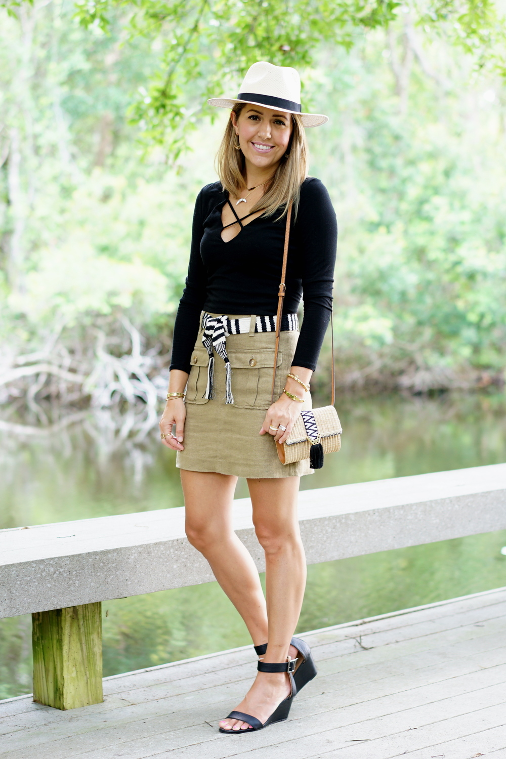 Panama hat, black criss cross top, khaki cargo skirt