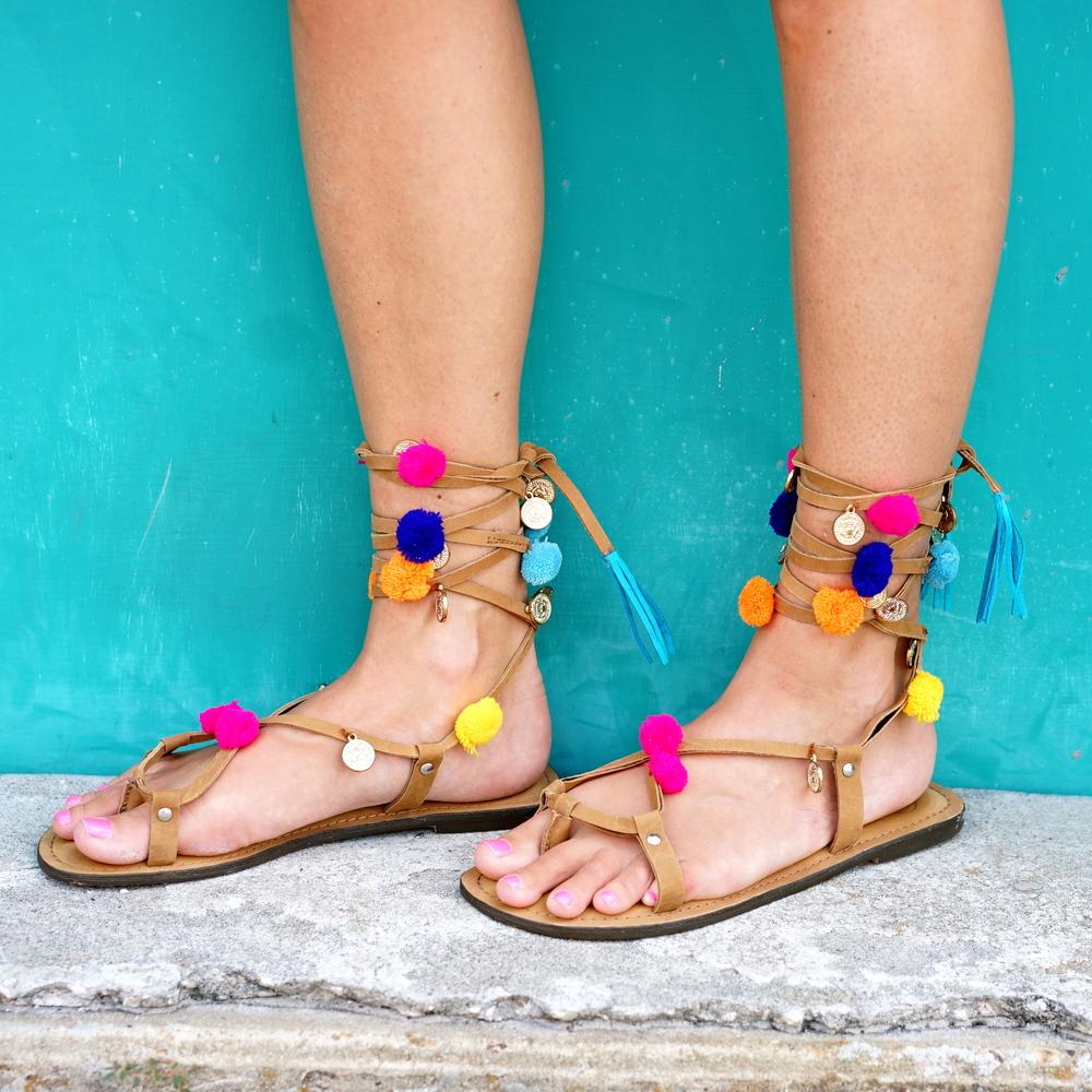Pom pom sandals, $64