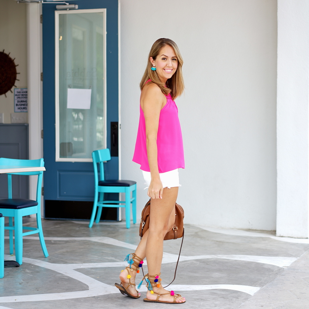 Pink tank top, white shorts, pom pom sandals