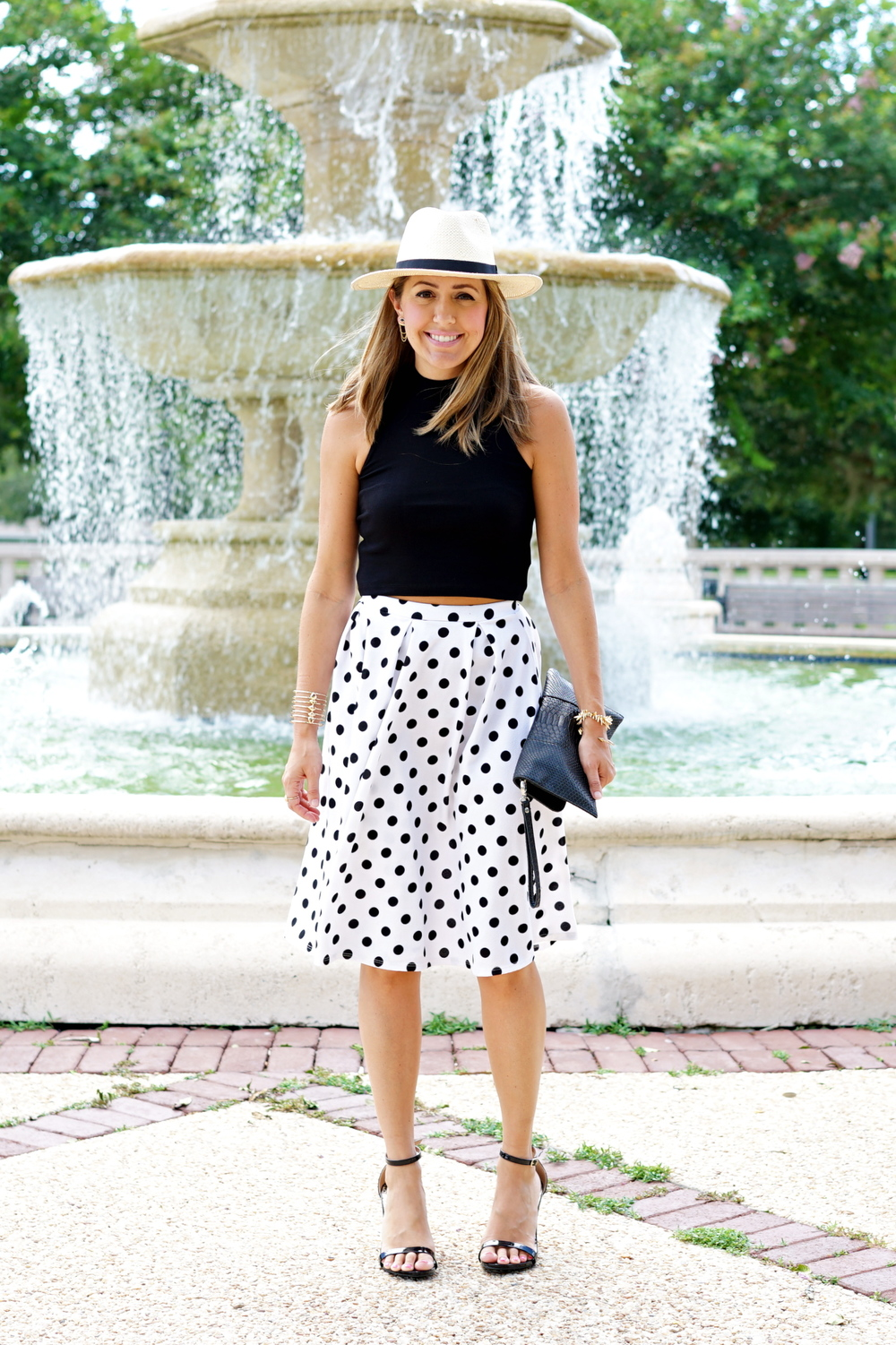 Black sleeveless turtleneck, full polka dot skirt