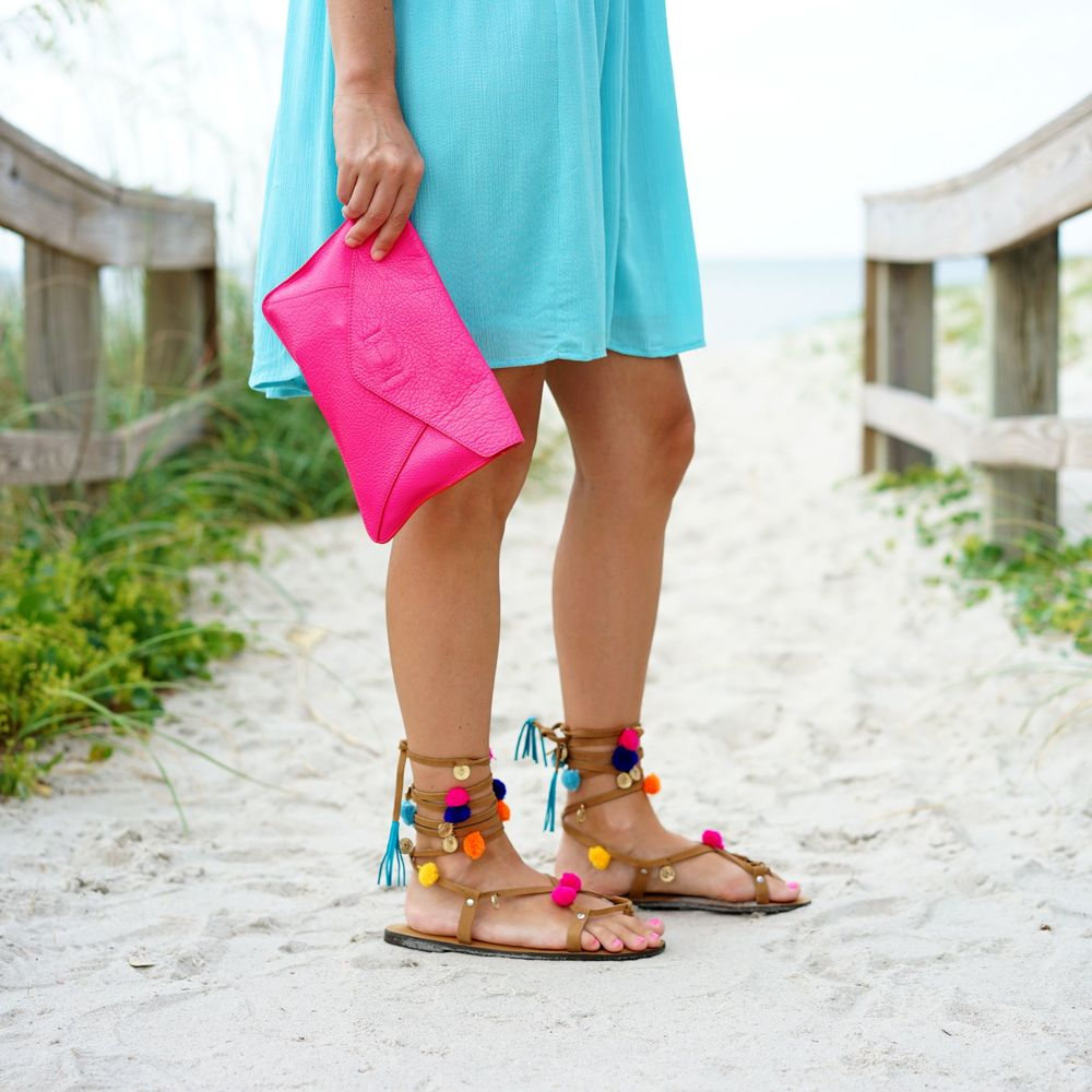 Turquoise dress, hot pink clutch, pom pom sandals