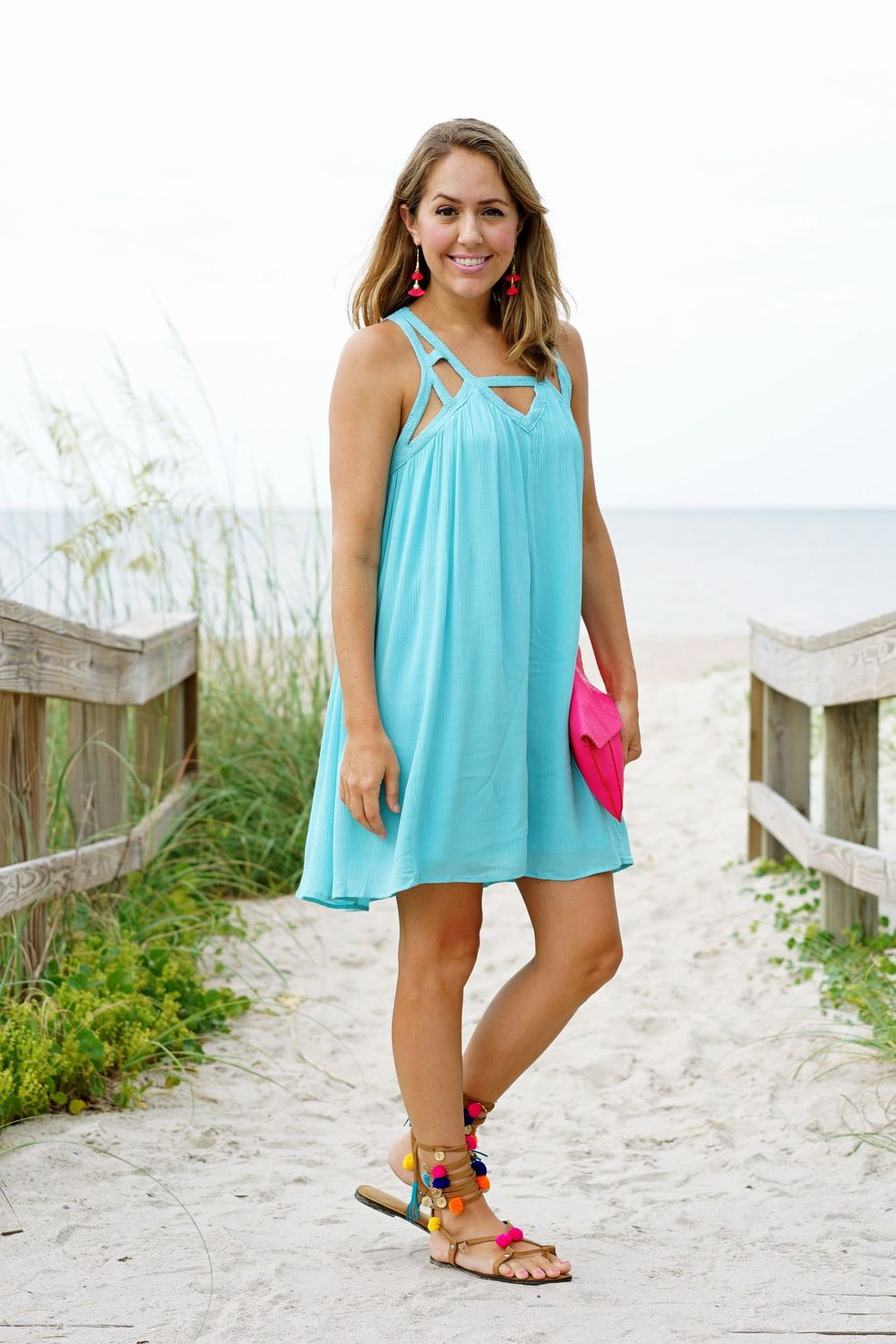 Turquoise crisscross dress, hot pink clutch, pom pom sandals