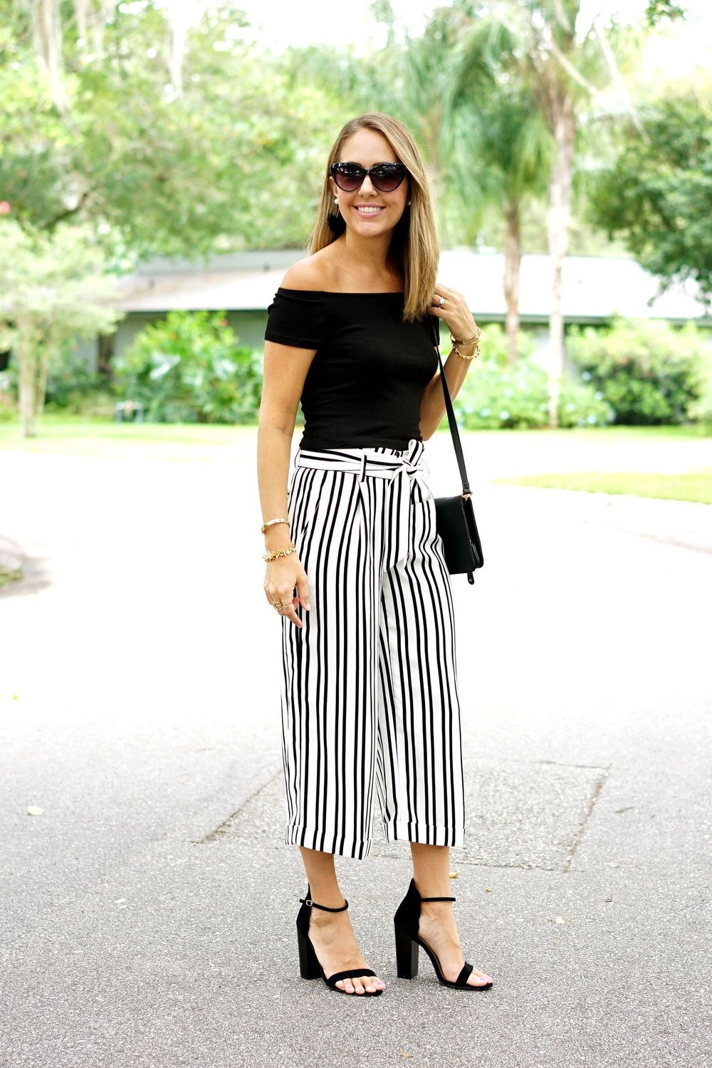 Black off shoulder top, stripe pants