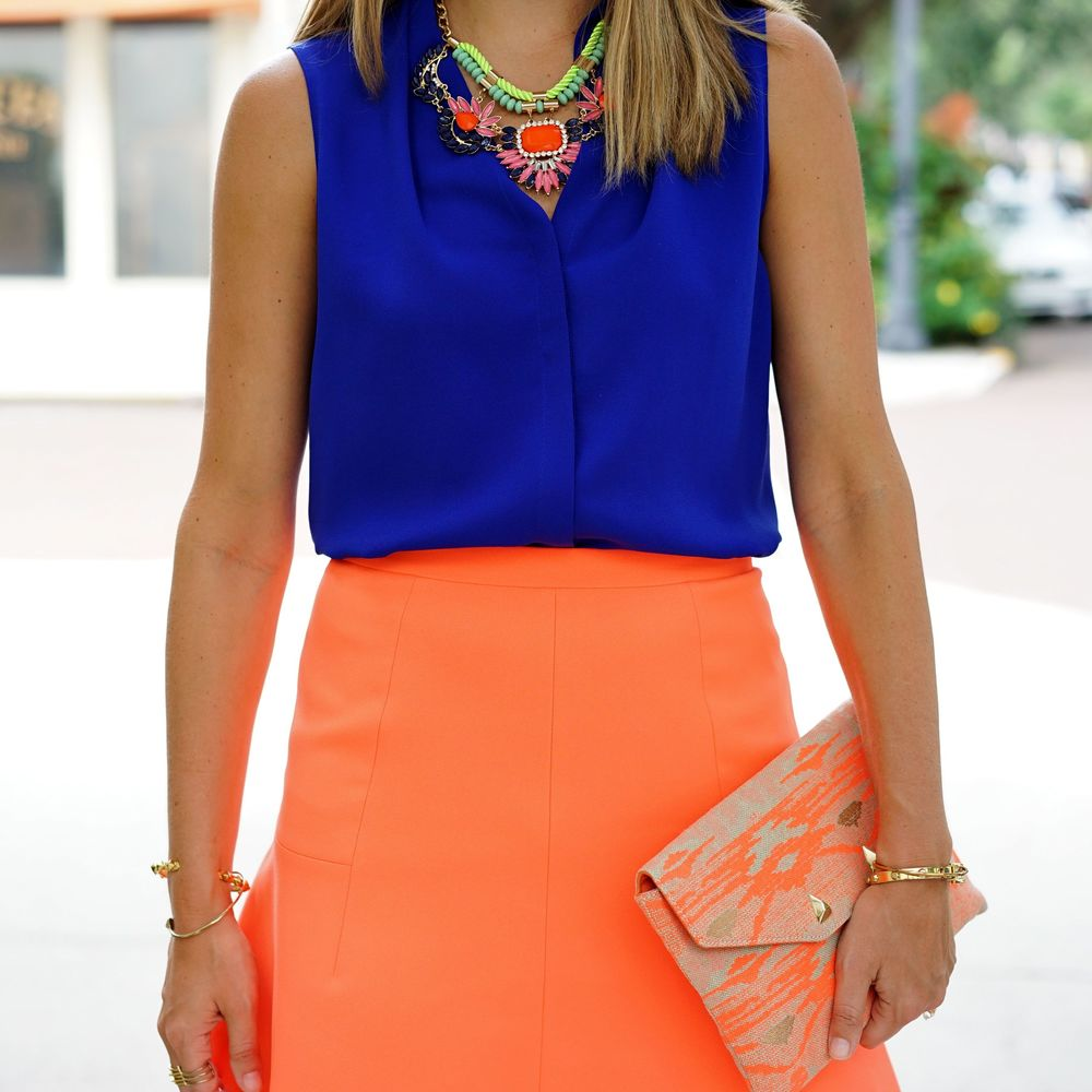 Cobalt top, orange skirt, statement necklace
