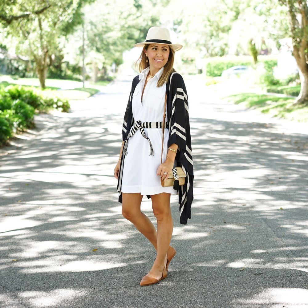 Striped poncho, white shirt dress, panama hat