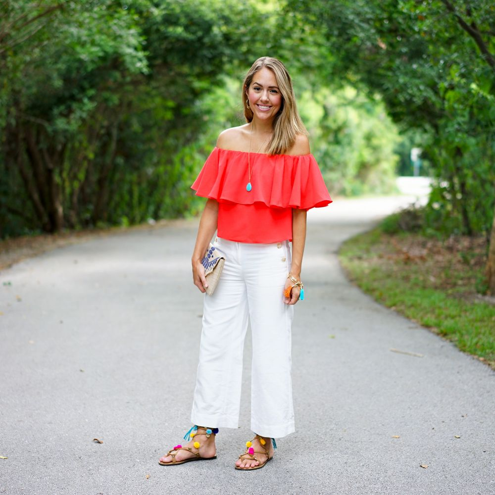 Red off shoulder top, pom pom sandals