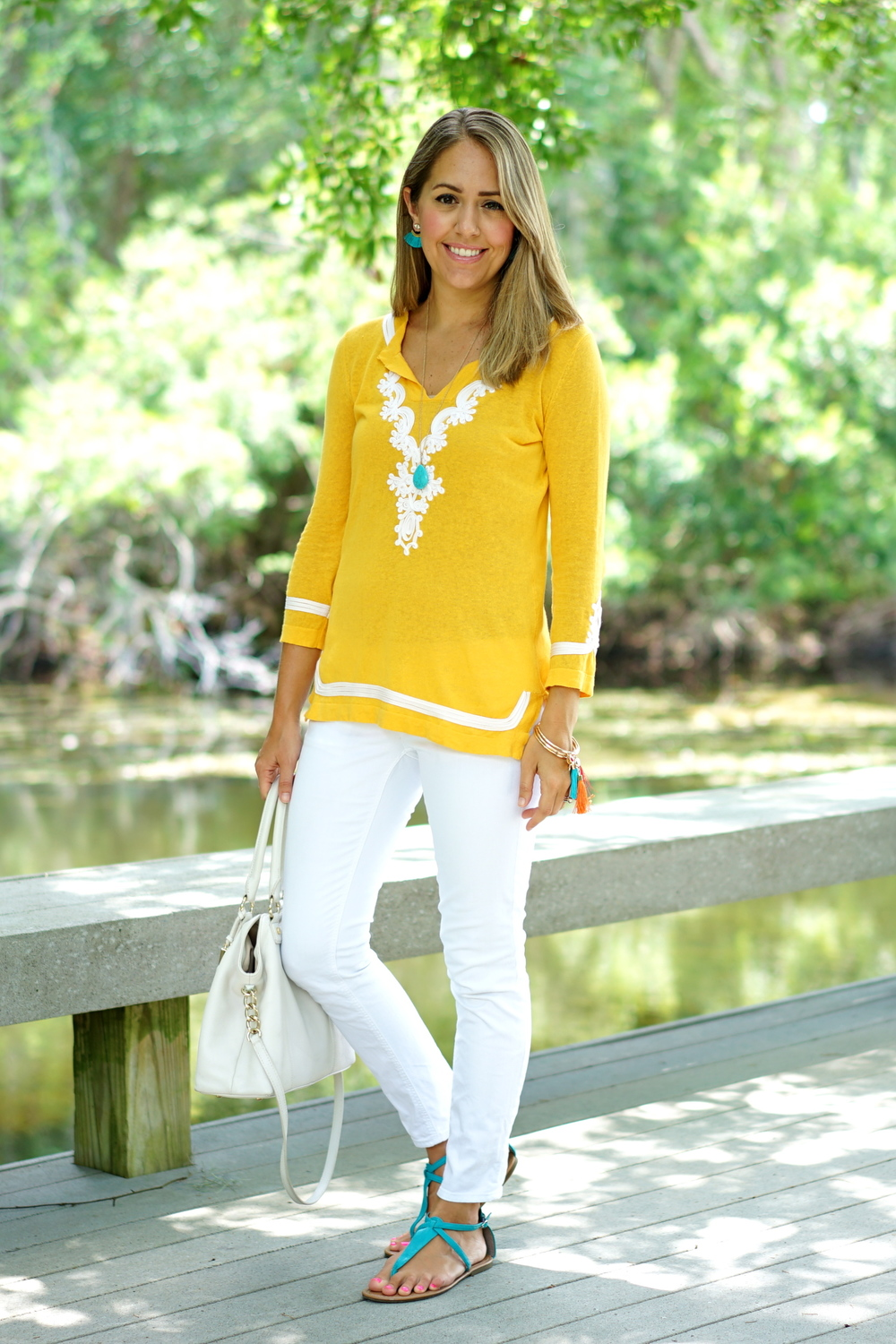 Yellow sweater, white jeans, turquoise sandals