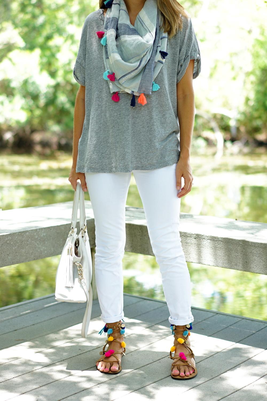 Tassel scarf, white jeans, pom pom sandals