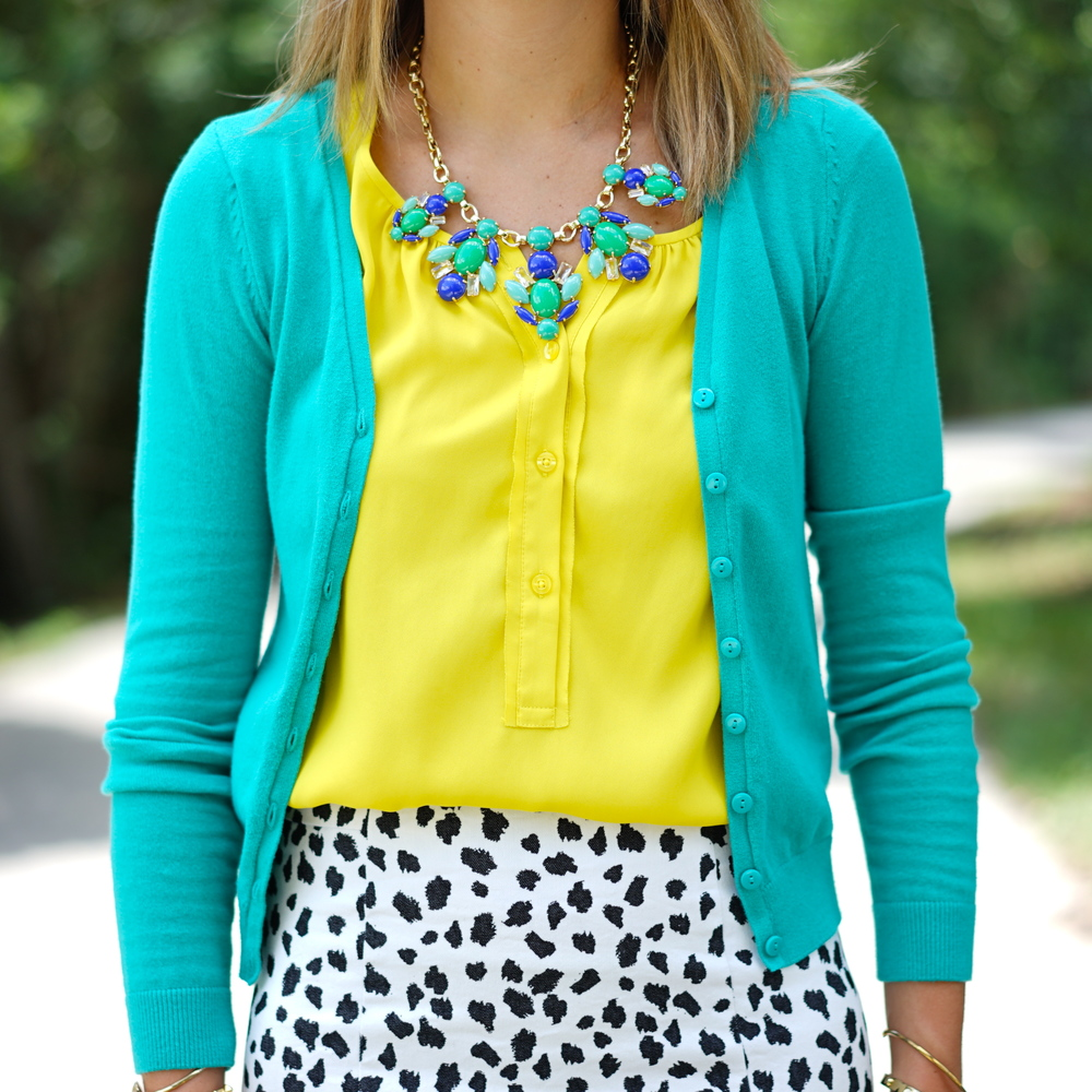 Turquoise cardigan, yellow top, Dalmatian print skirt