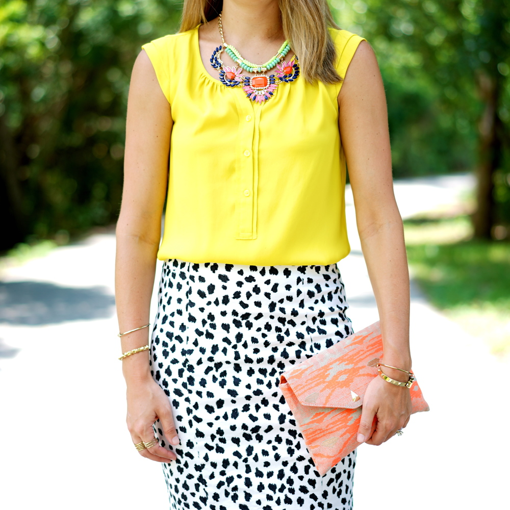 Yellow top, Dalmatian print skirt, statement necklace