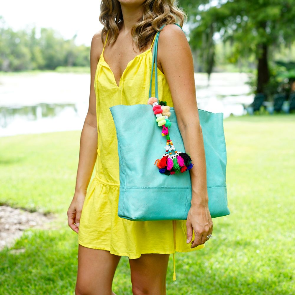 Yellow swim cover up, turquoise beach bag