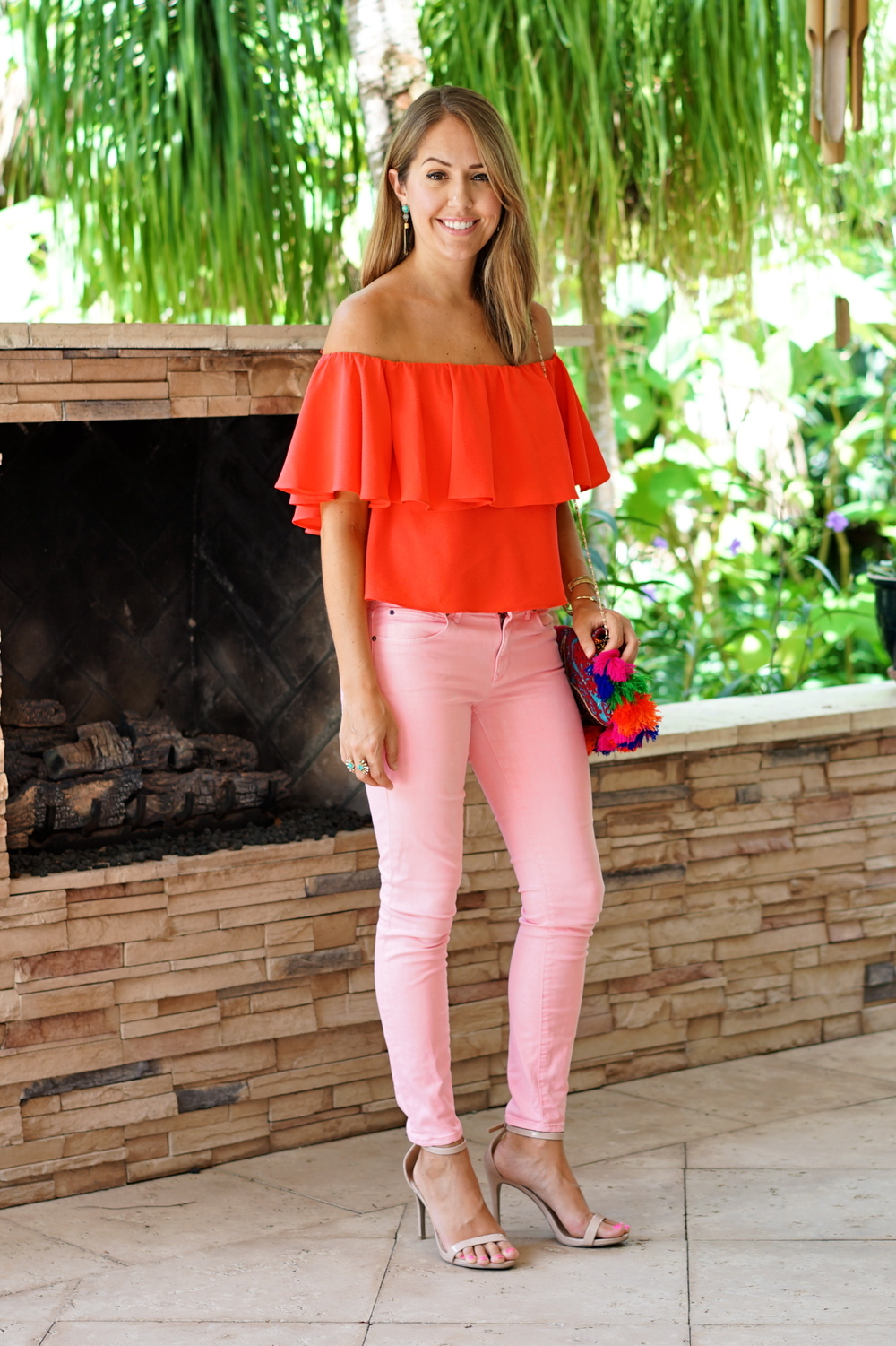 Red off shoulder top, coral jeans
