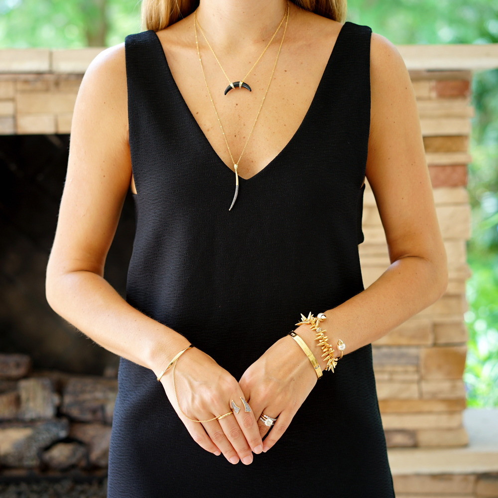 Black cut out dress with delicate jewelry