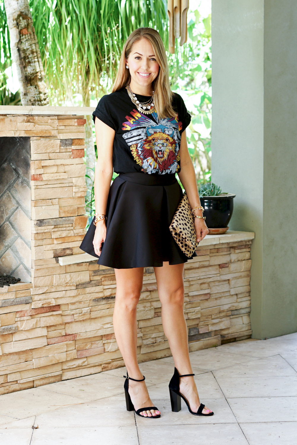 Graphic tee, skater skirt, leopard clutch, block heels