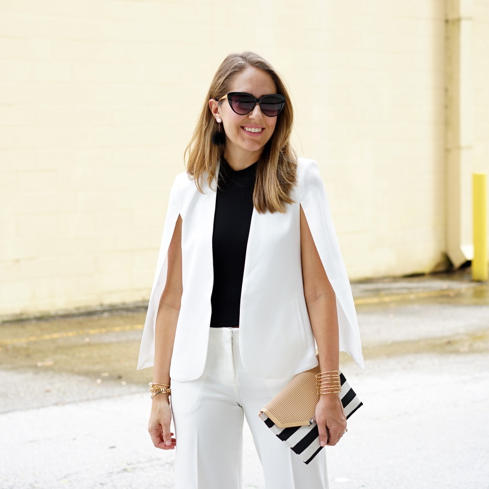 White cape blazer with white cropped trousers