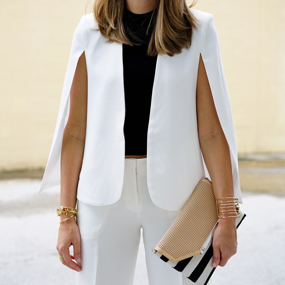 White cape blazer with black turtleneck