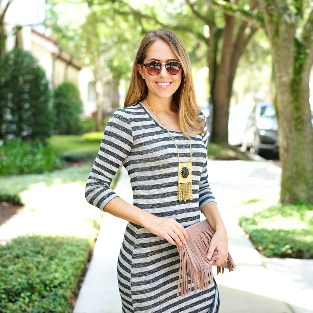 Striped maxi with fringe clutch