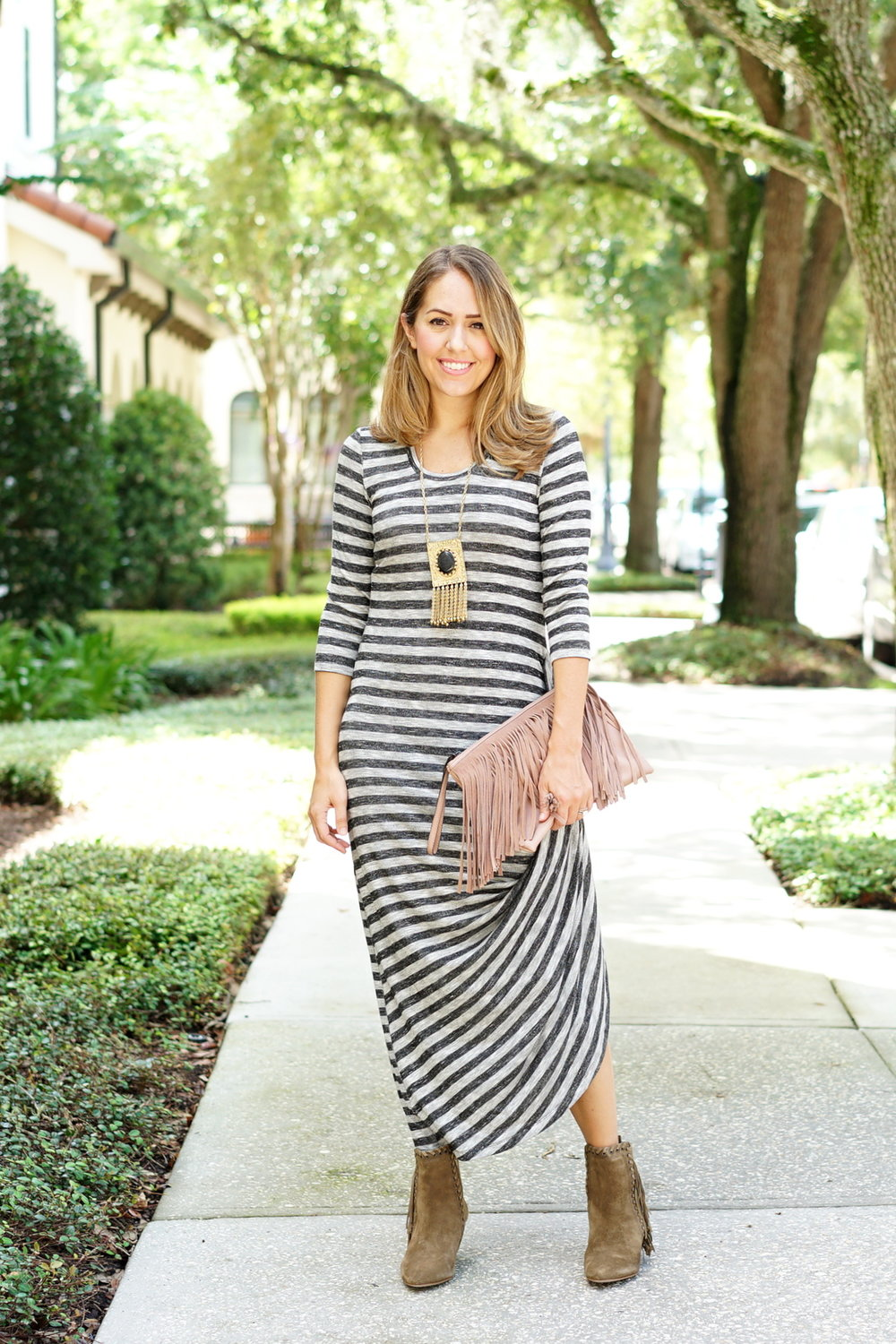 Striped gathered maxi with fringe clutch