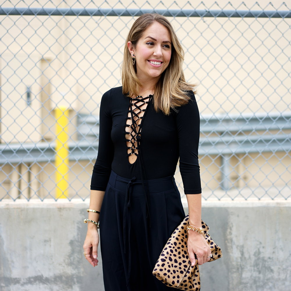 Lace up bodysuit with black culottes and leopard clutch