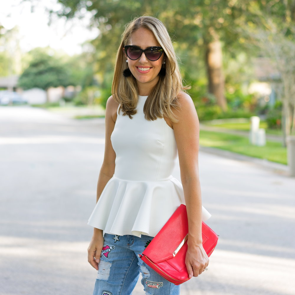 White peplum top with patch jeans