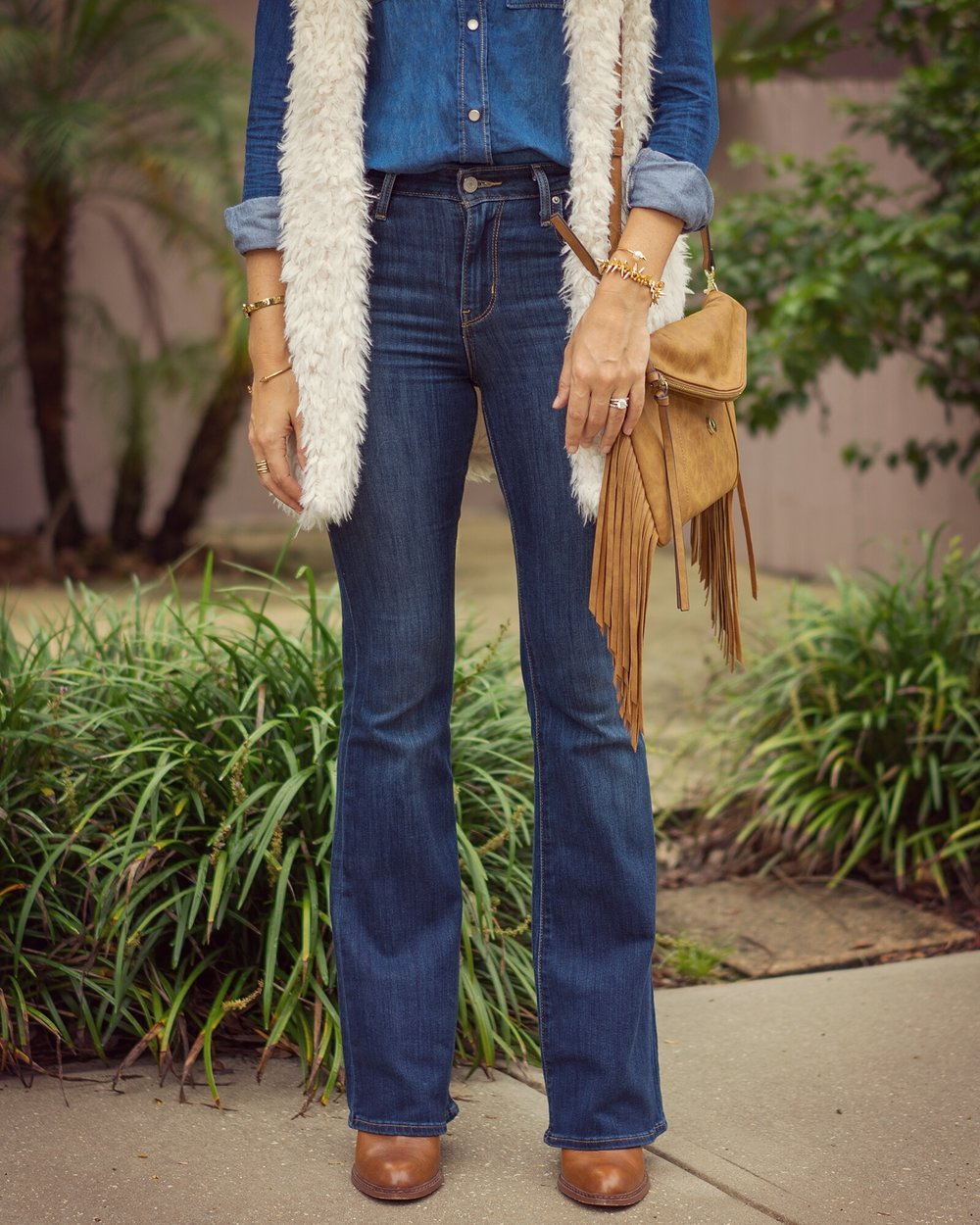 Fuzzy vest, chambray shirt, flare jeans