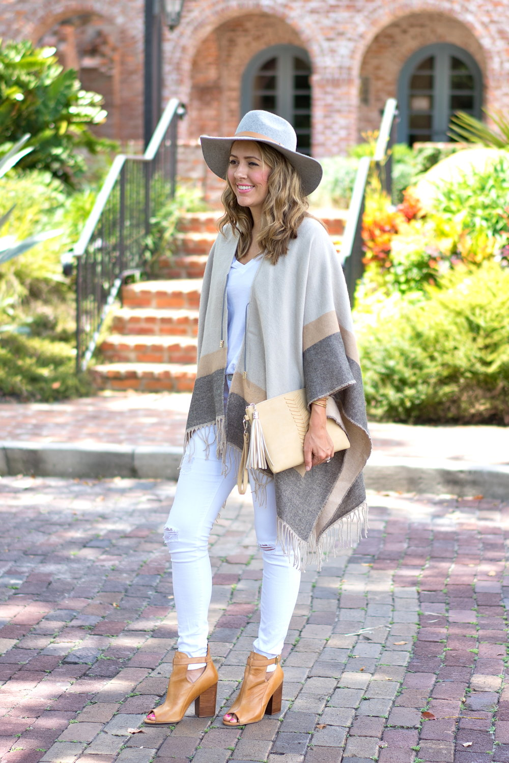 Neutral striped poncho with white jeans