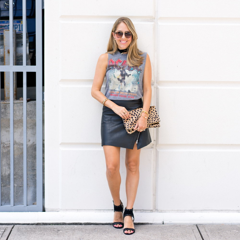 Concert tee, leather skirt, leopard clutch