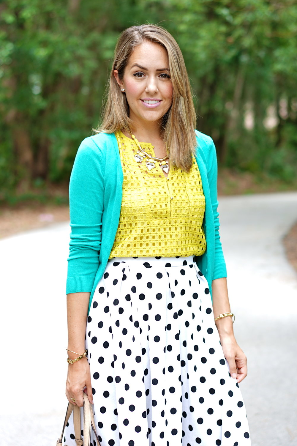 Green cardigan, yellow top, polka dot skirt