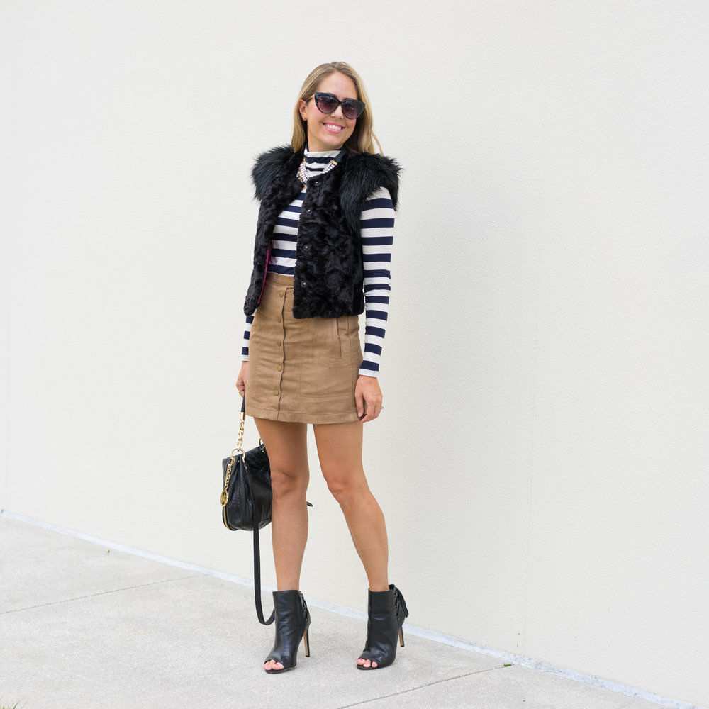 Stripe turtleneck, black faux fur vest