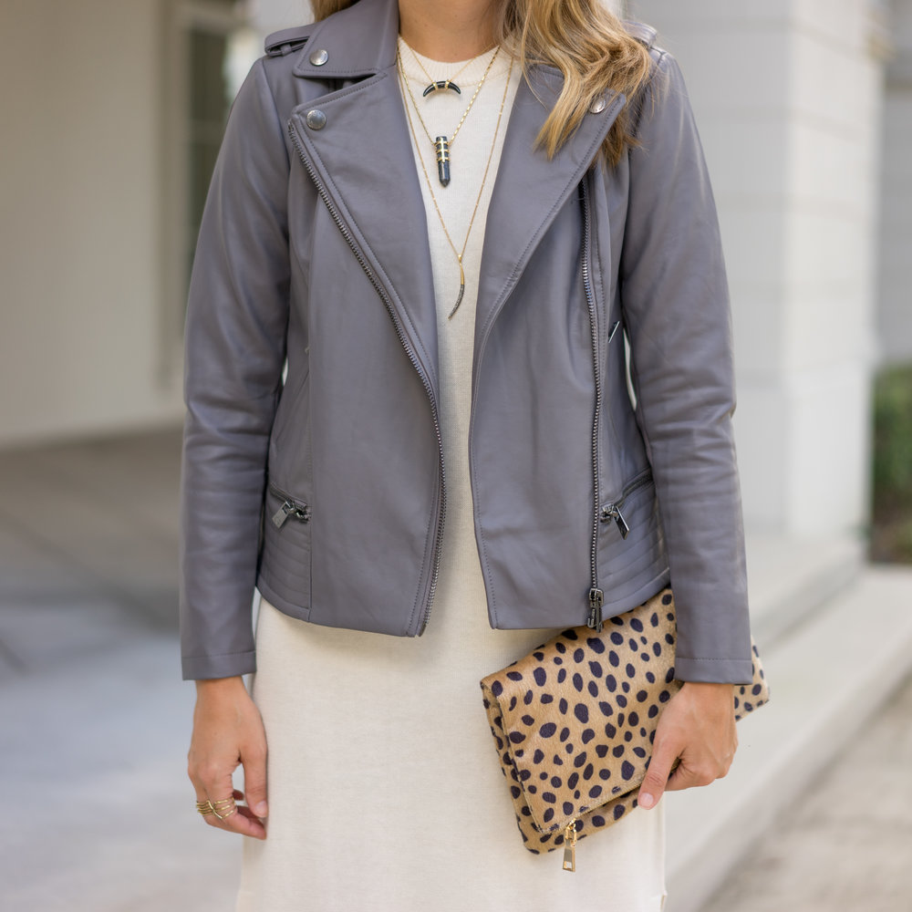 Ivory sweater dress, gray leather jacket