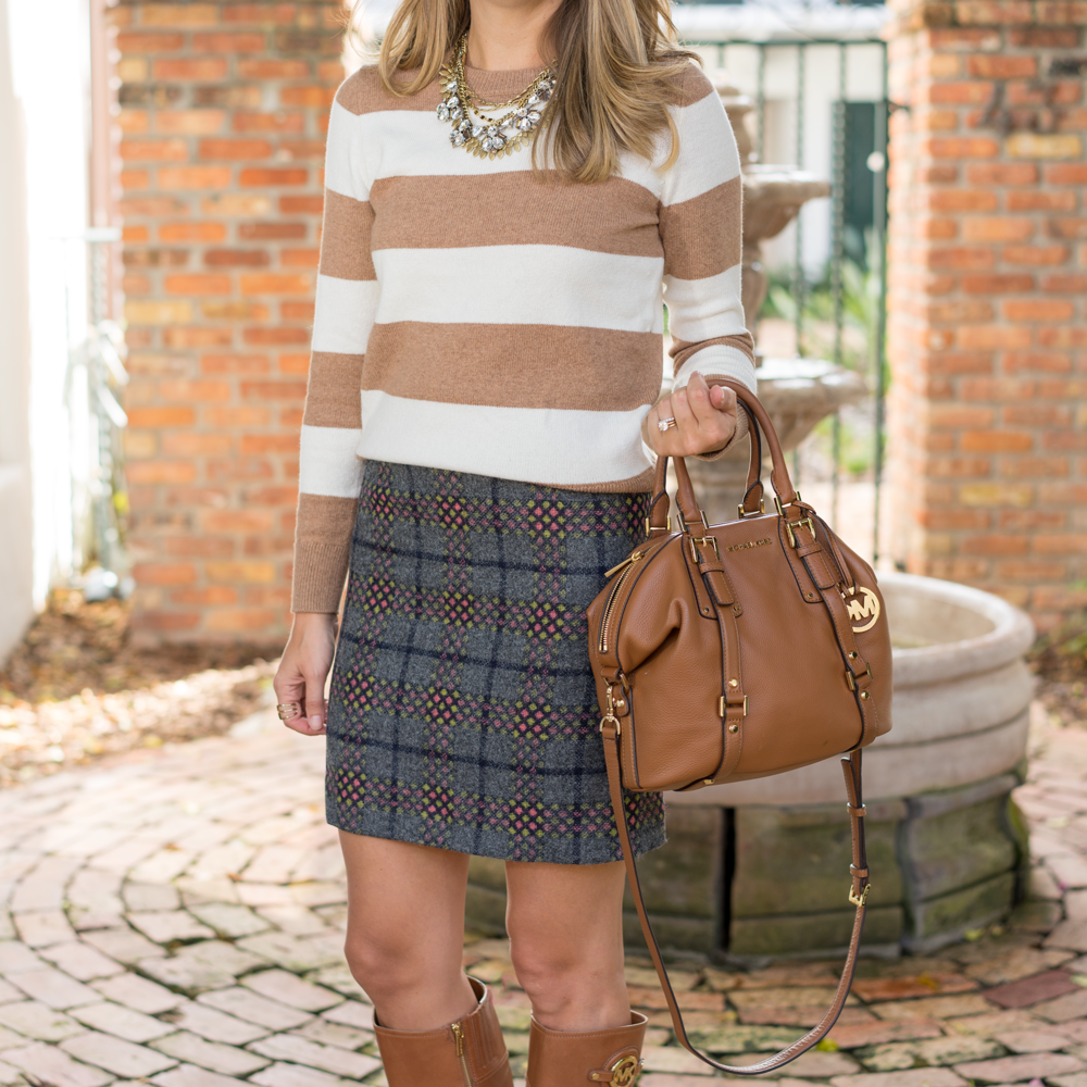Striped sweater and plaid skirt, riding boots