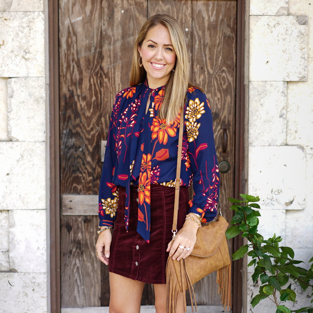 Floral top, corduroy skirt, fringe purse