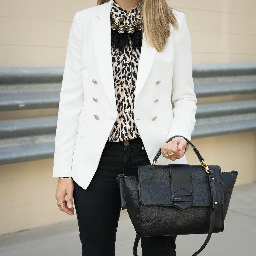 White blazer, leopard shirt, black feather necklace