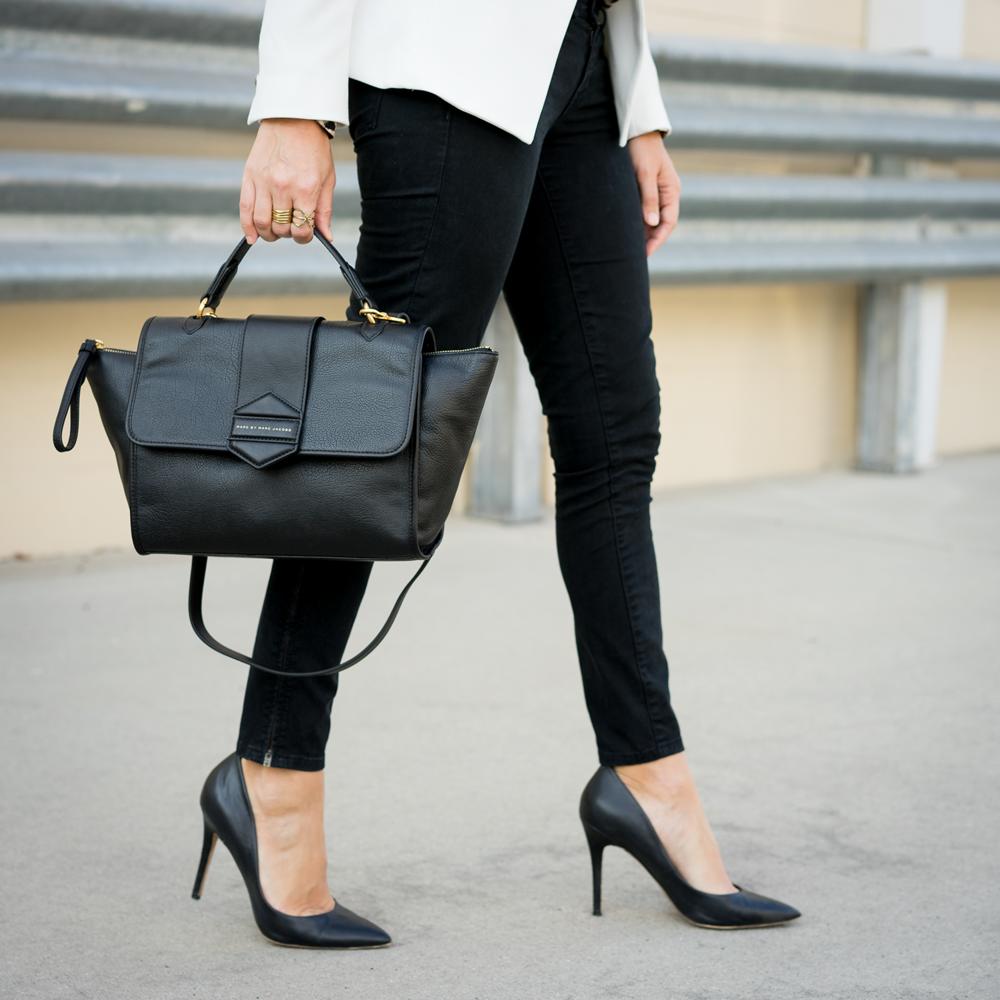 Black jeans, pumps, structured handbag