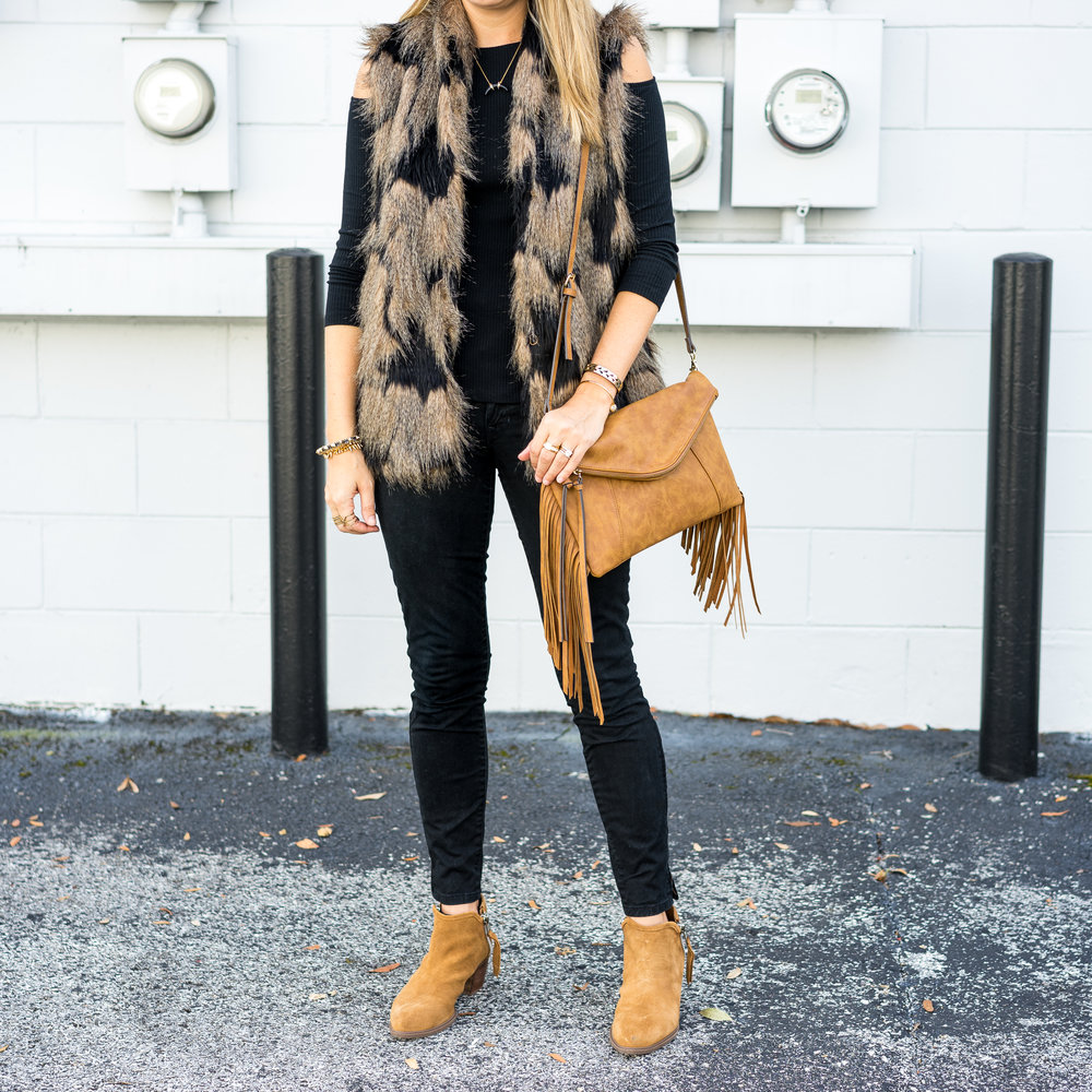 Faux fur vest, cold shoulder top, black jeans