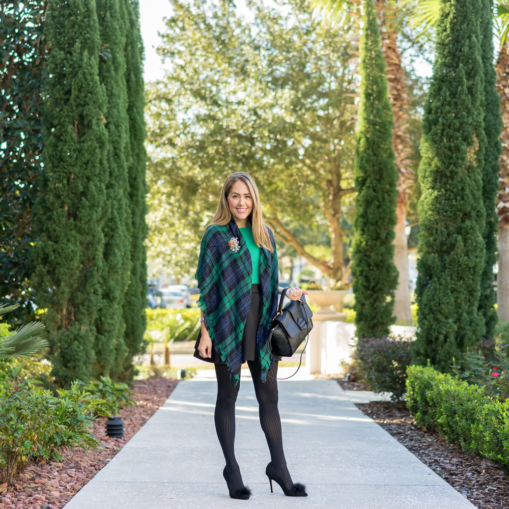 Green plaid scarf, black full skirt, tights