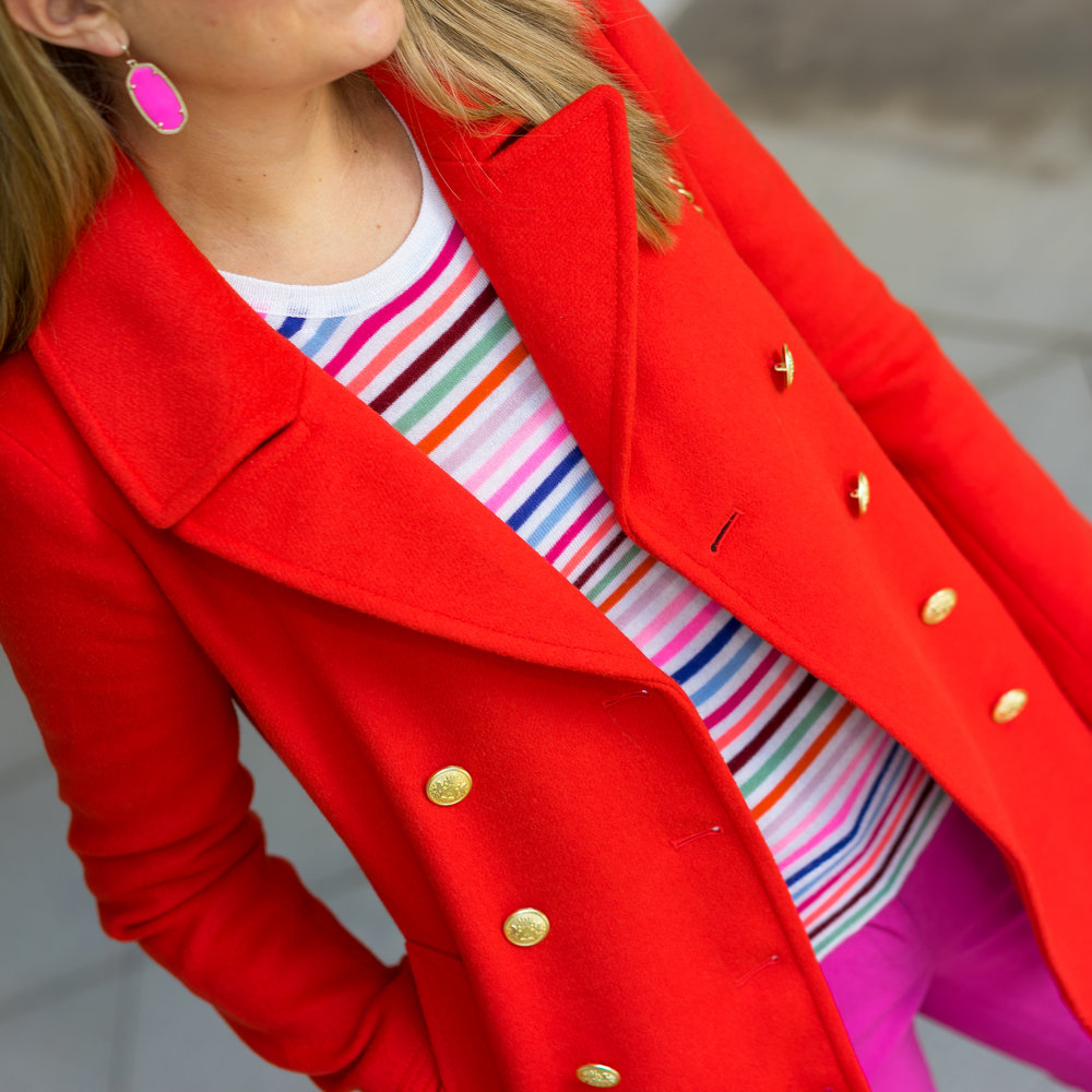 Red coat, rainbow sweater, pink pants