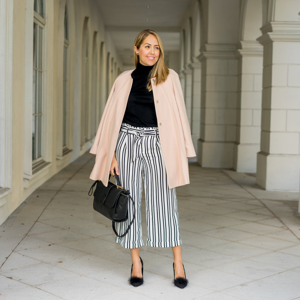 Pink coat, black turtleneck, striped pants
