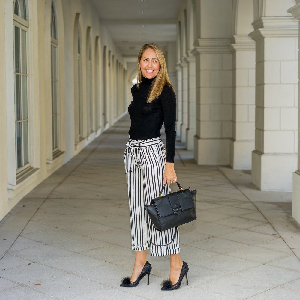 Black turtleneck, striped pants