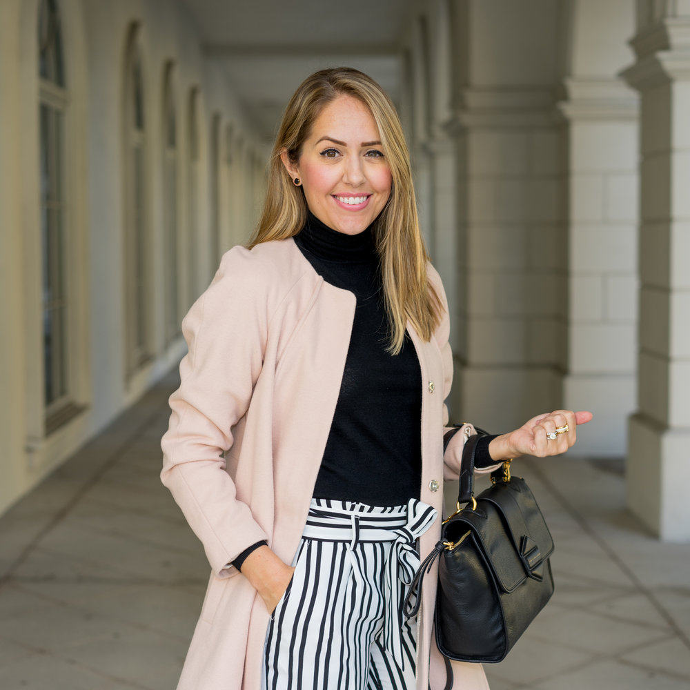Pink coat, black turtleneck, striped pants
