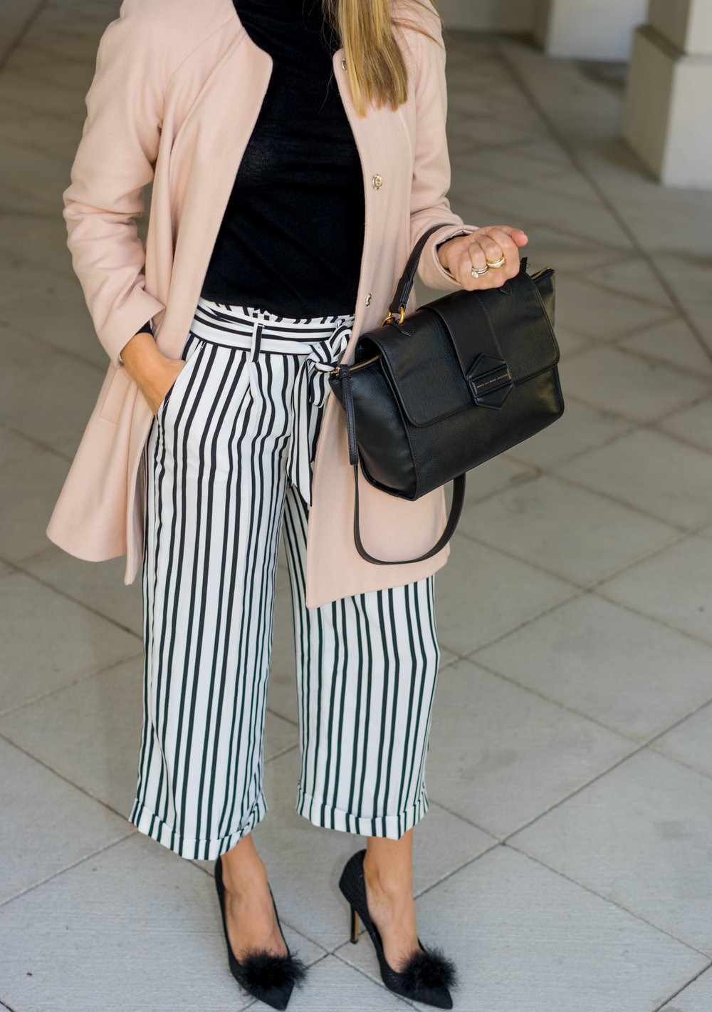 Pink coat, striped pants