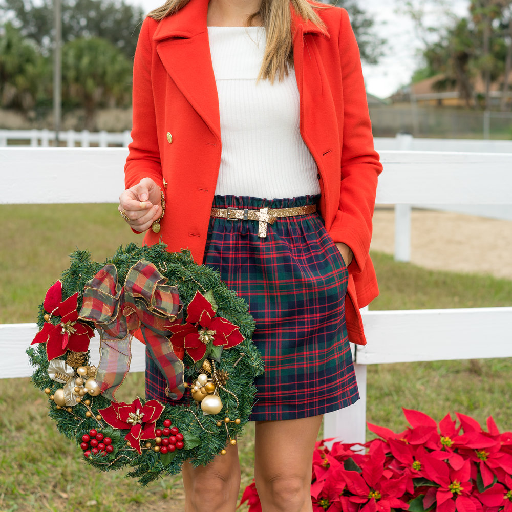 Red coat, glitter belt, plaid skirt