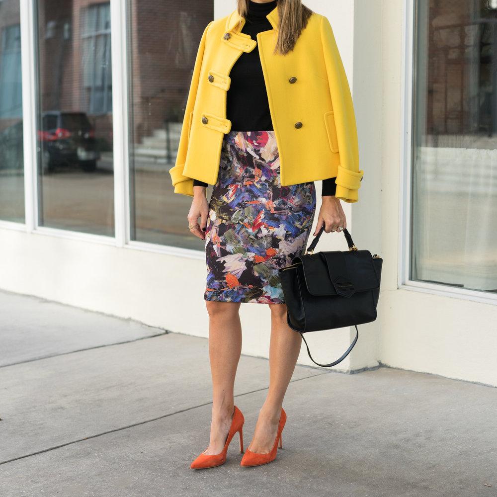 Yellow coat, floral skirt, orange heels