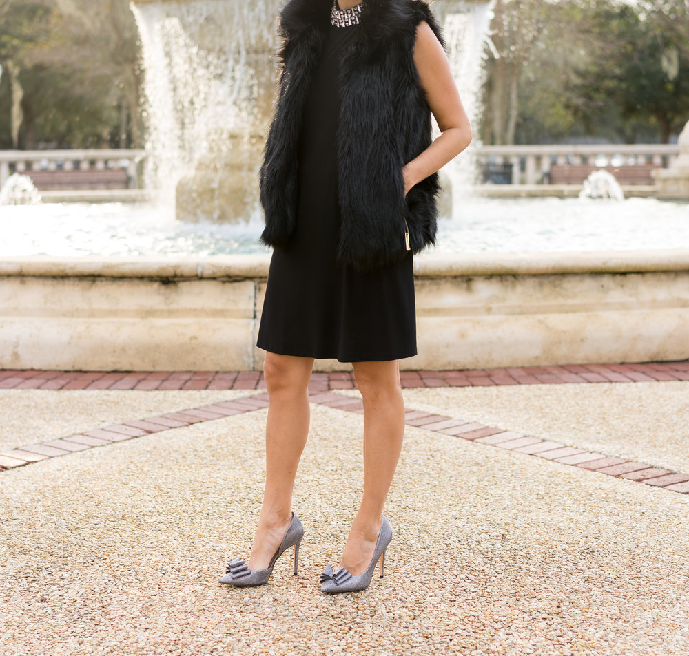 Black fur vest, black dress, bow shoes