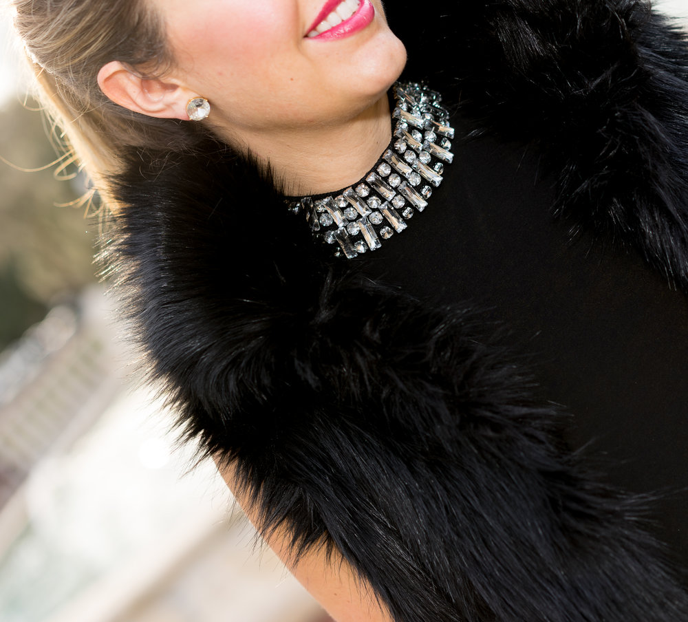 Black fur vest, jeweled neckline