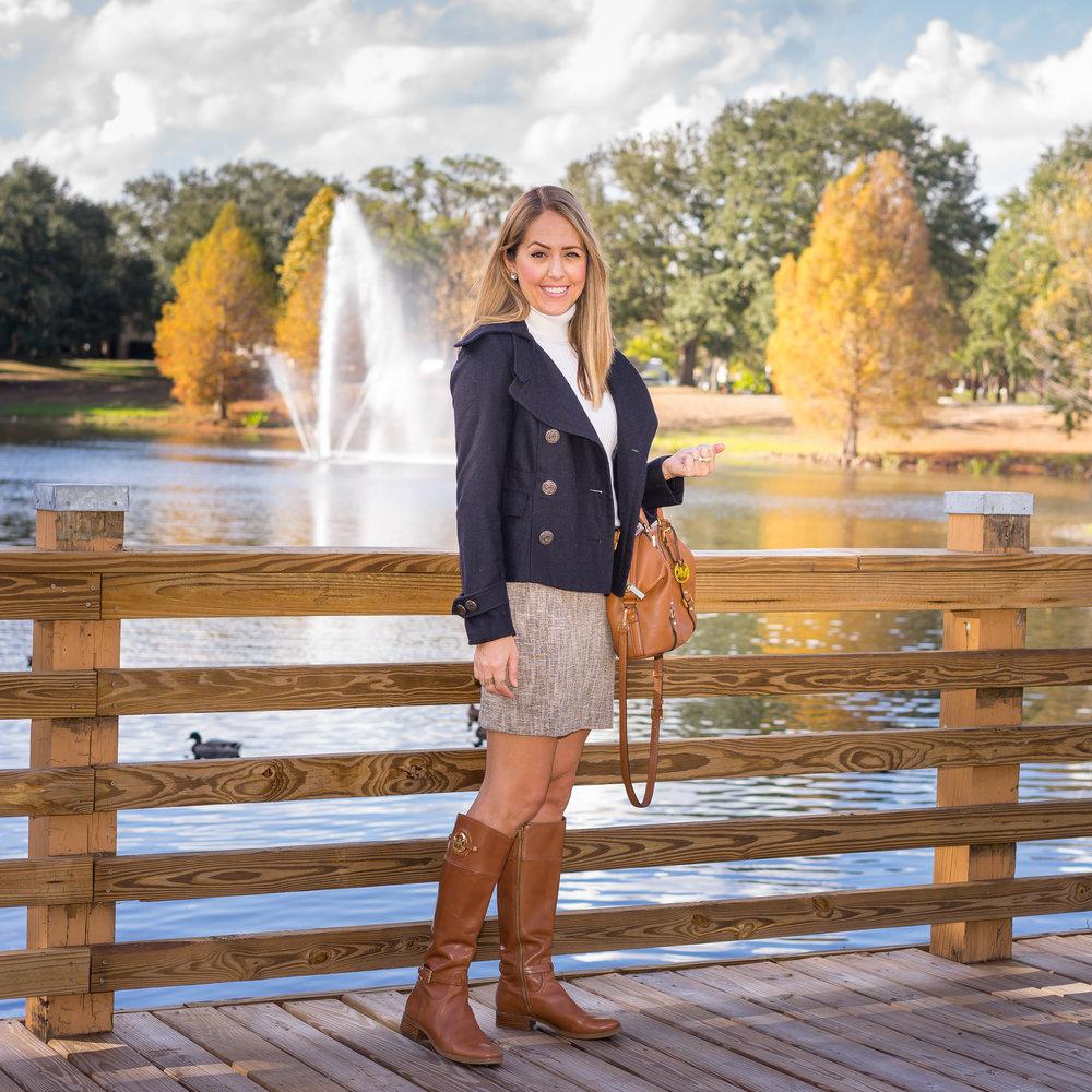 Navy coat, ivory turtleneck, tweed skirt, cognac riding boots
